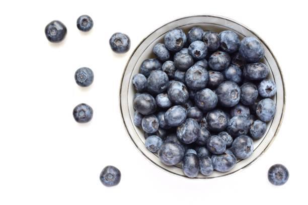 directly above shot of blueberries over white background - 藍莓 個照片及圖片檔