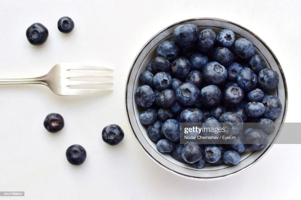 Directly Above Shot Of Blueberries Over White Background : Stock Photo