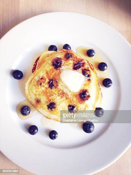 Directly above shot of blueberry pancakes in plate