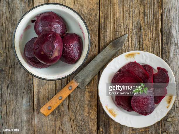 Directly Above Shot Of Boiled Beetroots In Bowl With Slices In Plate On Table