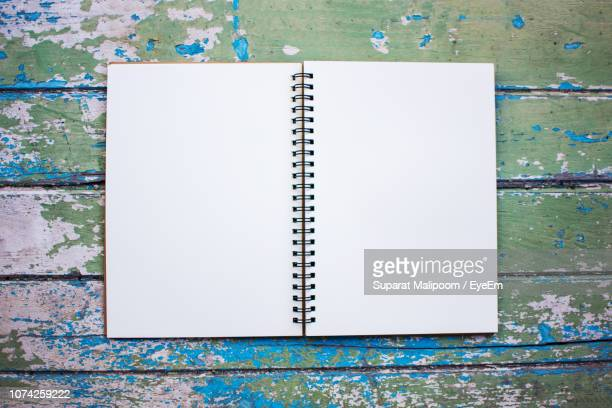 directly above shot of book on table - spiral notebook stock pictures, royalty-free photos & images