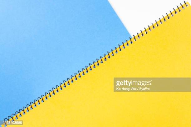directly above shot of book on two tone background - ツートンカラー ストックフォトと画像