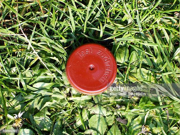 Directly Above Shot Of Bottle Cap On Grassy Field