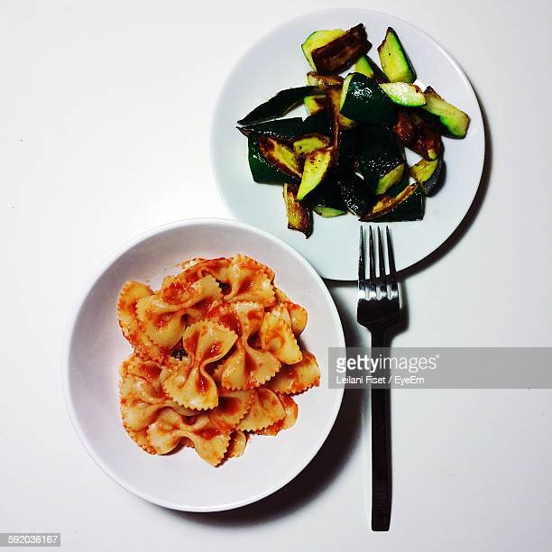 Directly Above Shot Of Bow Tie Pasta With Zucchini On Table