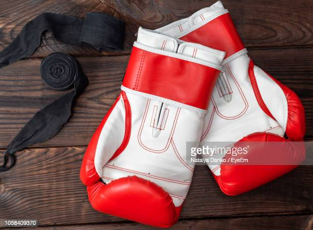 directly above shot of boxing gloves and belt on table - boxing belt stock pictures, royalty-free photos & images