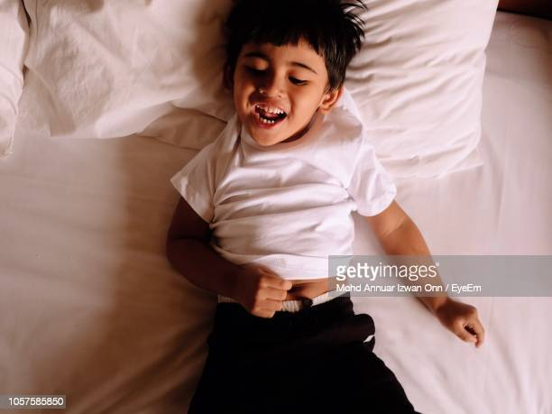 Directly Above Shot Of Boy Relaxing On Bed At Home 37dab61a097c8