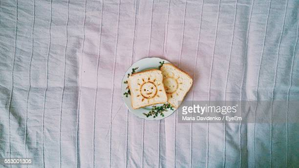 Directly Above Shot Of Breads In Plate On Bed