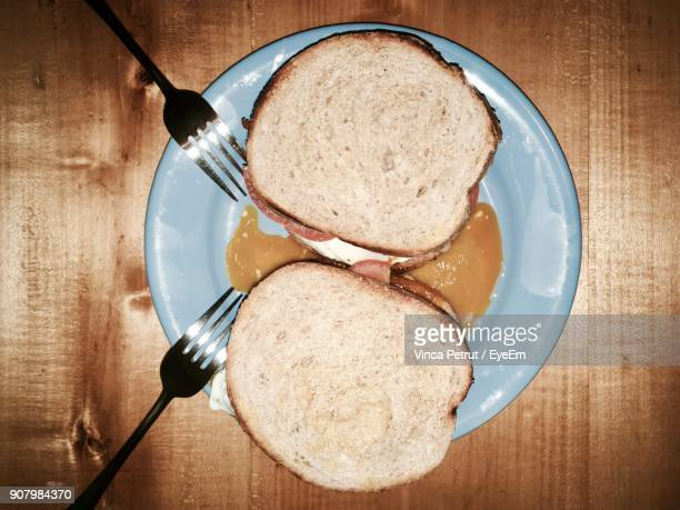 Directly Above Shot Of Breads In Plate On Wooden Table