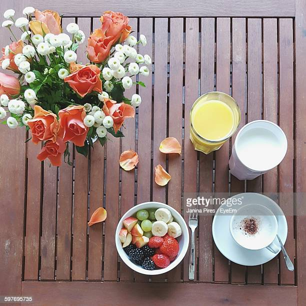 Directly Above Shot Of Breakfast And Flower Vase On Table