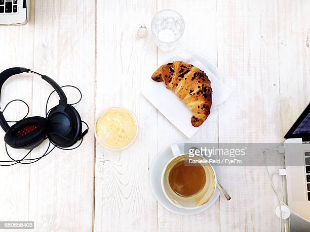 Directly Above Shot Of Breakfast By Headphones On Table