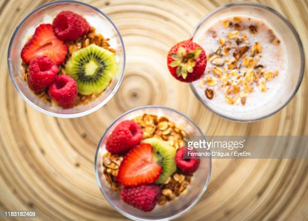 directly above shot of breakfast in cups on table - água stock pictures, royalty-free photos & images
