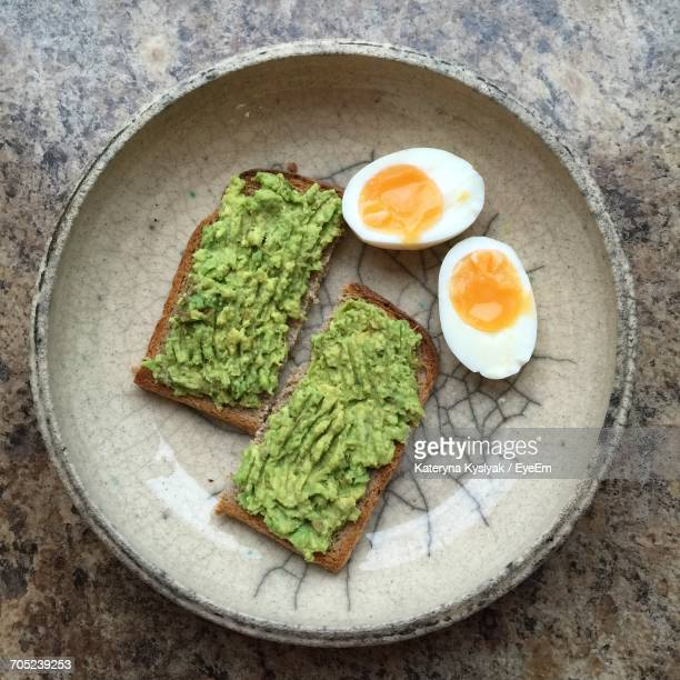 directly above shot of breakfast on table - avocado toast stockfoto's en -beelden