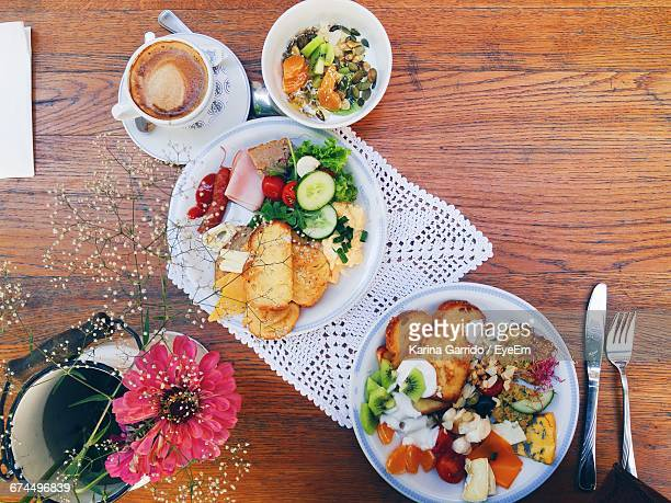 Directly Above Shot Of Breakfast Served In Plate On Wooden Table