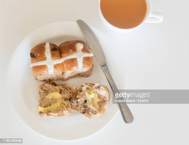 directly above shot of breakfast served on table - hot cross bun stock pictures, royalty-free photos & images