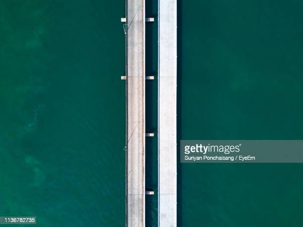 directly above shot of bridge over sea - parallel stock photos and pictures