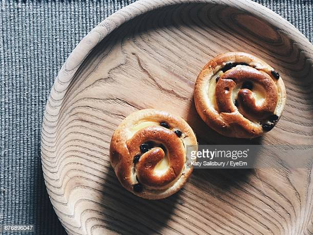Directly Above Shot Of Brioches In Wooden Plate On Table
