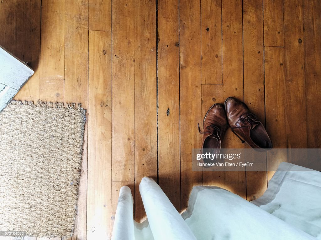 Directly Above Shot Of Brown Leather Shoes On Floorboard At Home : Stock Photo