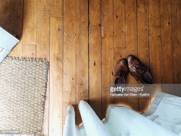 Directly Above Shot Of Brown Leather Shoes On Floorboard At Home