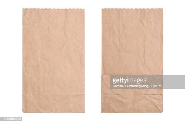 Directly Above Shot Of Brown Paper Bags Over White Background