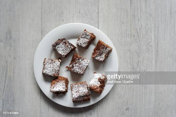 Directly Above Shot Of Brownies In Plate On Wooden Table