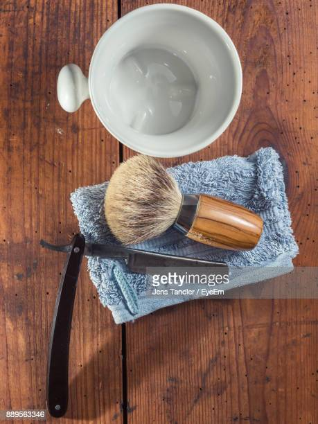 Directly Above Shot Of Brush And Razor On Table