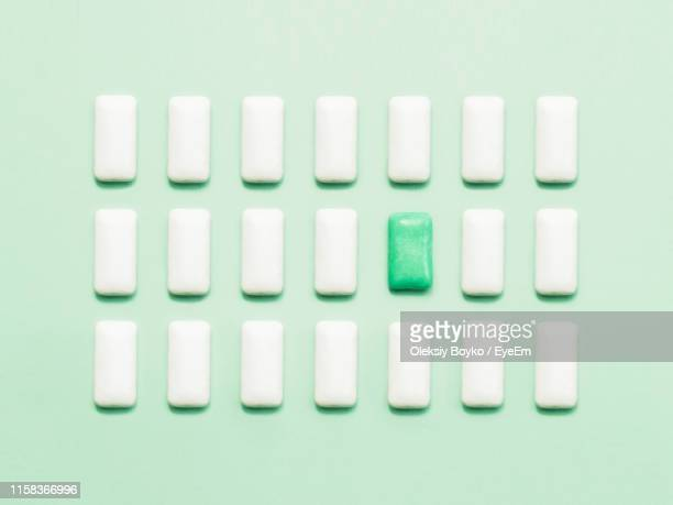 directly above shot of bubble gums over green background - bubble gum stock pictures, royalty-free photos & images