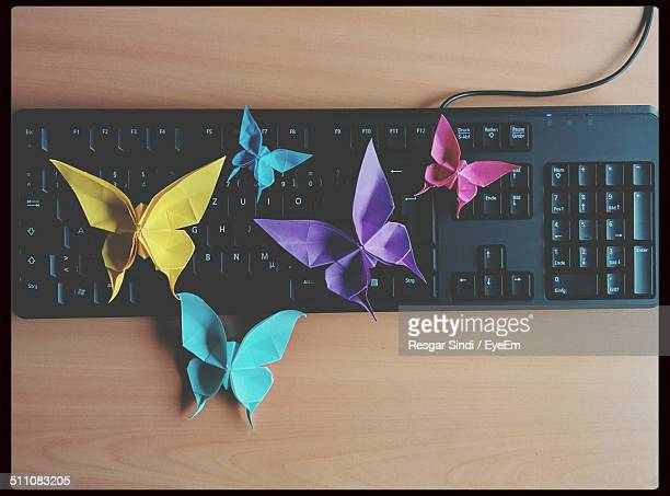 Directly above shot of butterflies origami on computer keyboard