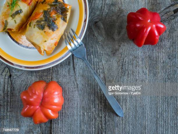 directly above shot of cabbage rolls served in plate on table - igor golovniov stock pictures, royalty-free photos & images