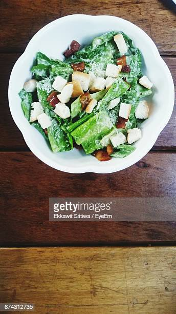 Directly Above Shot Of Caesar Salad On Wooden Table