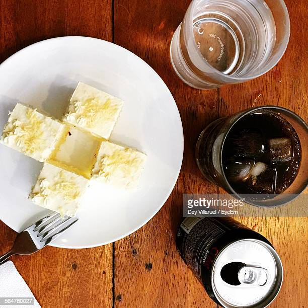 Directly Above Shot Of Cake On Plate By Drink Can