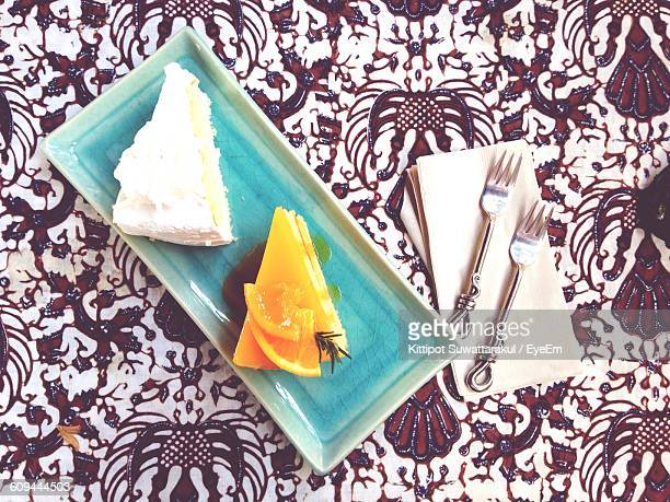 Directly Above Shot Of Cake Slices In Plate On Table