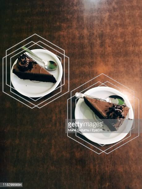 directly above shot of cake slices in plates on table - chocolate cake above stock pictures, royalty-free photos & images