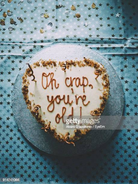Directly Above Shot Of Cake With Text On Table