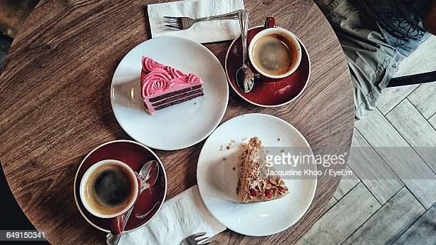 Directly Above Shot Of Cakes And Black Coffee On Table