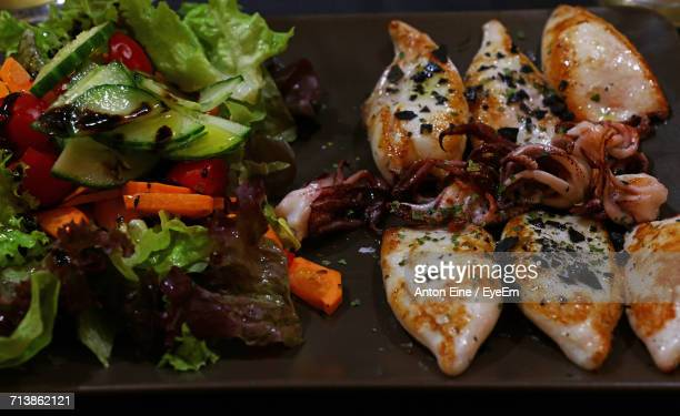 Directly Above Shot Of Calamari With Salad Served In Tray