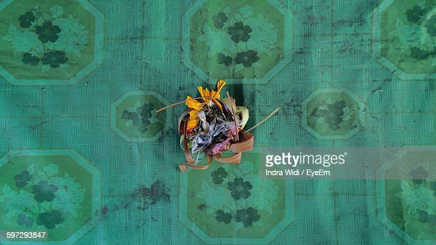 directly above shot of canang sari on fabric - balinese culture stock pictures, royalty-free photos & images