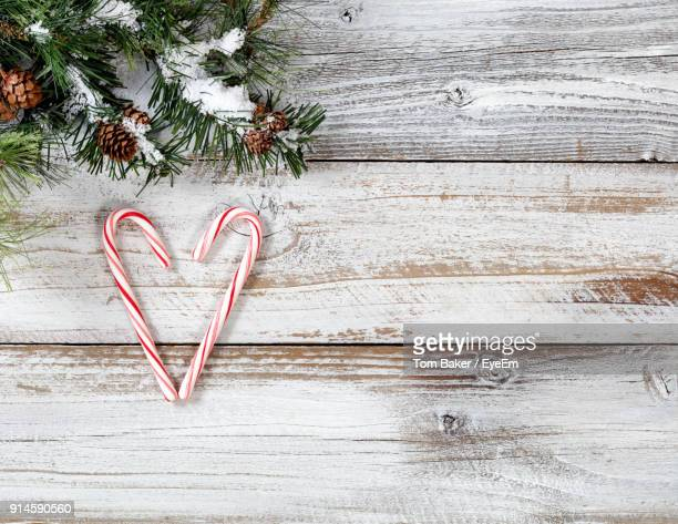 directly above shot of candy canes and christmas tree on table - candy cane stock pictures, royalty-free photos & images