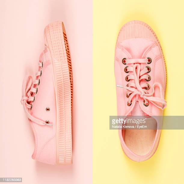 directly above shot of canvas shoes over colored background - canvas shoe stock pictures, royalty-free photos & images