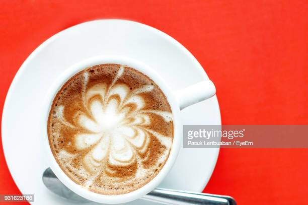 Directly Above Shot Of Cappuccino Against Red Background