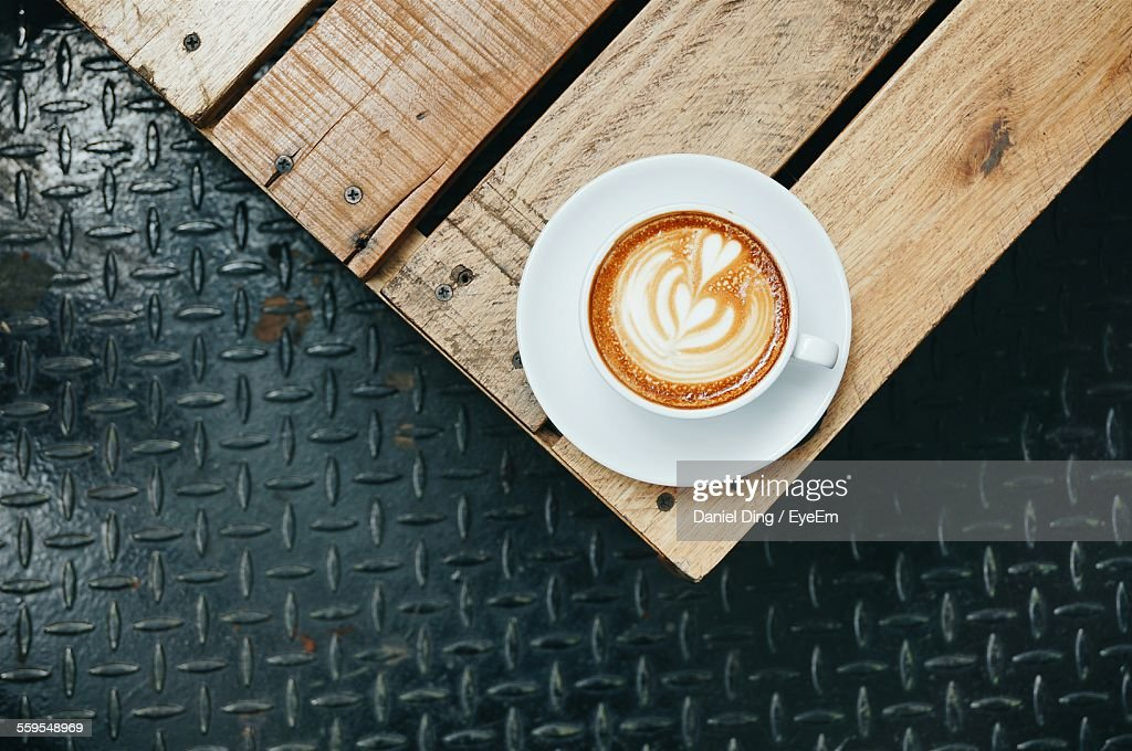 Directly Above Shot Of Cappuccino On Wooden Table : Stock Photo