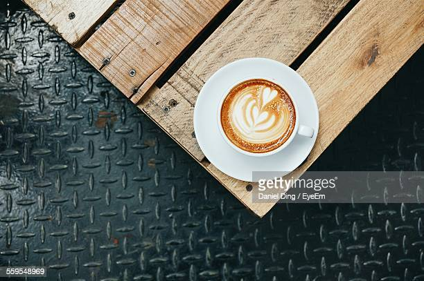 Directly Above Shot Of Cappuccino On Wooden Table