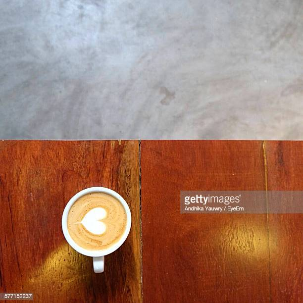 Directly Above Shot Of Cappuccino Served On Table In Cafe