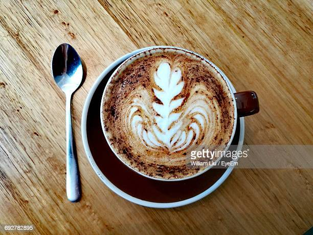 Directly Above Shot Of Cappuccino Served On Wooden Table