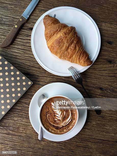 Directly Above Shot Of Cappuccino With Croissant Served On Table