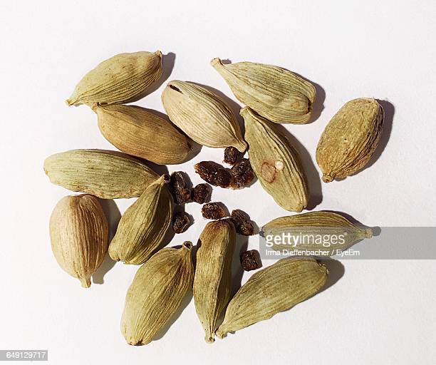 directly above shot of cardamoms against white background - cardamom stock photos and pictures