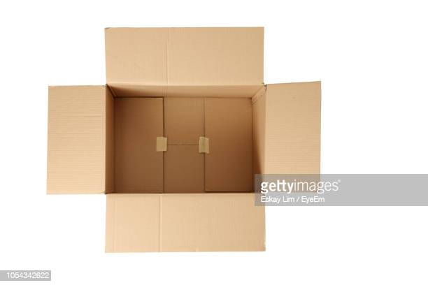 Directly Above Shot Of Cardboard Box Over White Background