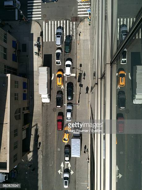 Directly Above Shot Of Cars On Street Amidst Buildings