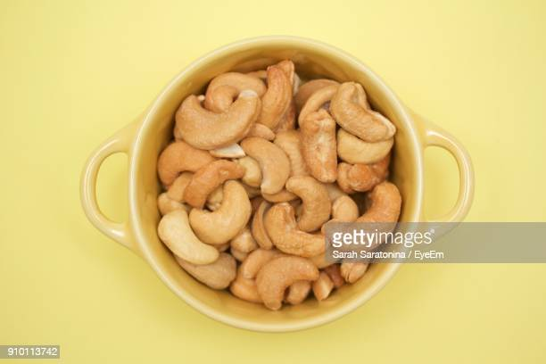 directly above shot of cashew in bowl - cashew stock pictures, royalty-free photos & images