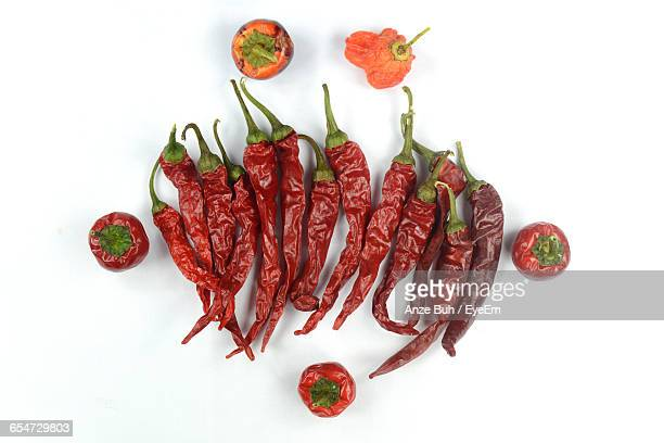Directly Above Shot Of Cayenne Peppers On White Background