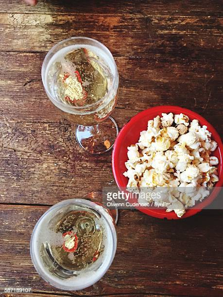 Directly Above Shot Of Champagne And Popcorn On Table